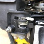 Close up of the Honda engine showing the choke lever in the off position